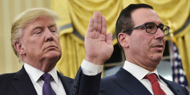 US President Donald Trump (L) watches as US Vice President (out of frame) administers the oath of office to Treasury Secretary Steven Mnuchin (R) in the Oval Office of the White House on February 13, 2017 in Washington, DC. / AFP / MANDEL NGAN        (Photo credit should read MANDEL NGAN/AFP/Getty Images)