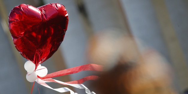 A heart-shaped balloon flies as Pope Francis leads a special audience with engaged couples, to celebrate Saint Valentine's day, in Saint Peter's Square at the Vatican February 14, 2014. REUTERS/Tony Gentile (VATICAN - Tags: RELIGION)