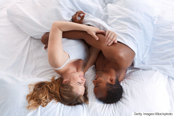 mixed race couple bed
