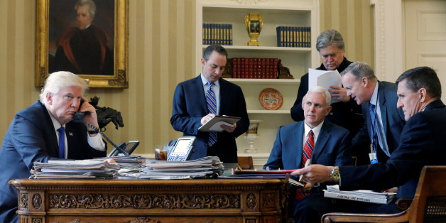 U.S. President Donald Trump (L-R), joined by Chief of Staff Reince Priebus, Vice President Mike Pence, senior advisor Steve Bannon, Communications Director Sean Spicer and National Security Advisor Michael Flynn, speaks by phone with Russia's President Vladimir Putin in the Oval Office at the White House in Washington, U.S. January 28, 2017. REUTERS/Jonathan Ernst