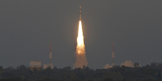 India's Polar Satellite Launch Vehicle (PSLV) C-20 blasts off, carrying Indo-French satellite SARAL from the Satish Dhawan space centre at Sriharikota, north of the southern Indian city of Chennai February 25, 2013. The Indian rocket carried seven satellites - the Indo-French satellite SARAL, world's first smart phone-operated nano satellite, a space telescope satellite and four other foreign satellites, local media reported on Monday. REUTERS/Babu (INDIA - Tags: SCIENCE TECHNOLOGY TPX IMAGES OF