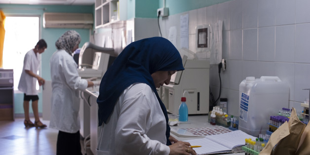 Doctors and technicians complete medical tests at a private clinic in Algiers, Algeria. (Photo by Monique Jaques/Corbis via Getty Images)