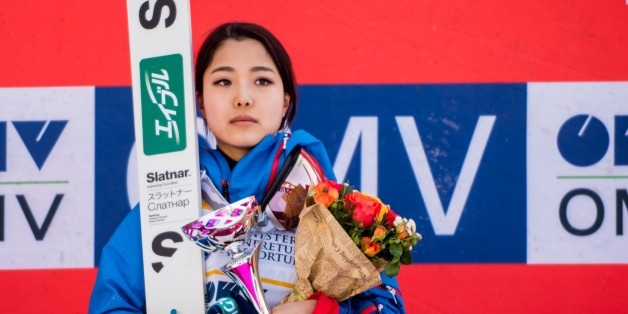 First placed Takanashi Sara of Japan poses on the podium after the Normal hill individual probe during the second day at the FIS Ski Jumping World Cup in Rasnov, central Romania, on January 29, 2017.  (Photo by Catalin Adrian Soare/NurPhoto via Getty Images)