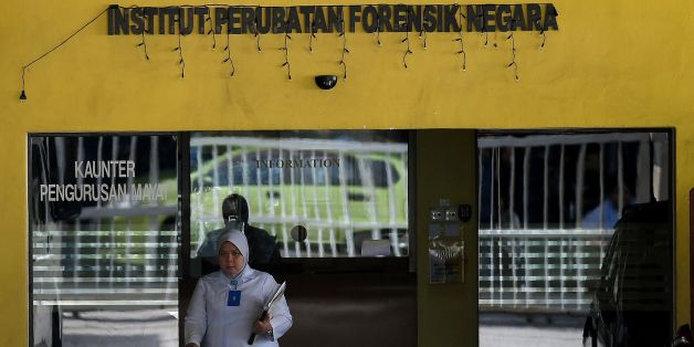 A Malaysian forensic official walks out of the Forensic wing at the Hospital Kuala Lumpur on February 16, 2017, where the body of a North Korean man suspected to be Kim Jong-Nam, half-brother of a North Korean leader Kim Jong-Un, is being kept.Malaysia will return the body of the half-brother of North Korea's leader, the country's deputy prime minister said on February 16, as police probing the airport assassination arrested a second woman. / AFP / Manan VATSYAYANA        (Photo credit should re