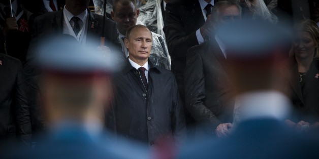 Belgrade, Serbia  - October 16, 2014: Russian President seen through the soldiers during the military parade 'March of the victorious' in Belgrade. President Vladimir Putin of Russia arrived in Belgrade to commemorate the city's liberation by the Red Army and Yugoslav Partisans in 1944. during World War II.