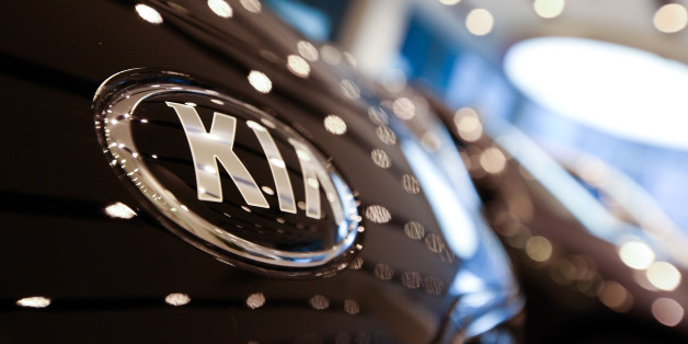 The Kia Motors Corp. logo is displayed on a vehicle in the lobby of the company's headquarters in Seoul, South Korea, on Monday, Jan. 23, 2017. Kia is scheduled to report full-year results on Jan. 25. Photographer: SeongJoon Cho/Bloomberg via Getty Images