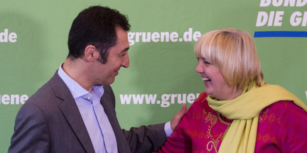 German green Party Die Gruenen co-leaders  Cem Oezdemir (L) and Claudia Roth (R) greet each other at the start of a meeting of her party's executive board at their headquarters in Berlin, on September 30, 2013, as exploratory talks with Chancellor's victorious conservatives on forming a coalition government are expected a week after German elections. German Chancellor Angela Merkels CDU announced today it will start talks with the centre-left Social Democratic Party (SPD) on October 4, 2013 on f