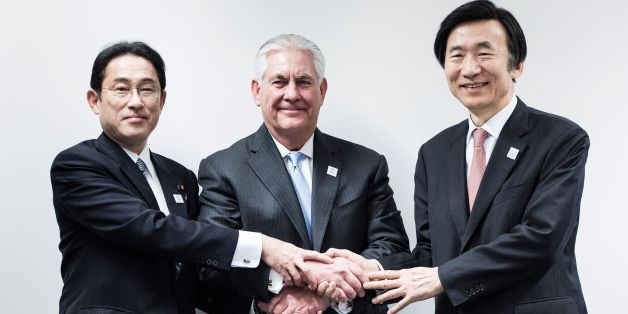 Japan's Foreign Minister Fumio Kishida (L), US Secretary of State Rex Tillerson (C) and South Korean Foreign Minister Yun Byung-Se (R) shake hands before a meeting at the World Conference Center February 16, 2017 in Bonn, Germany.