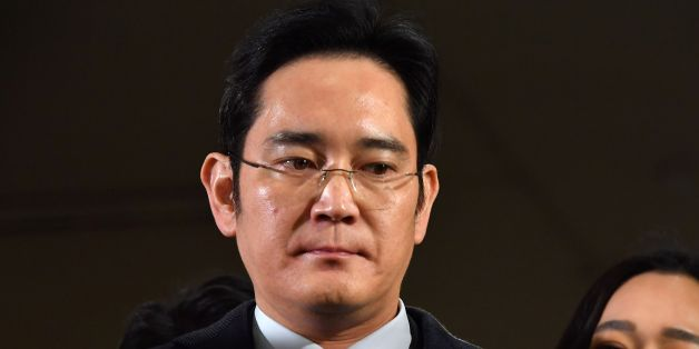 Lee Jae-yong, vice chairman of Samsung Electronics, arrives to be questioned as a suspect in a corruption scandal that led to the impeachment of South Korea's President Park Geun-Hye, at the office of the independent counsel in Seoul on February 13, 2017.  / AFP / POOL / JUNG Yeon-Je        (Photo credit should read JUNG YEON-JE/AFP/Getty Images)