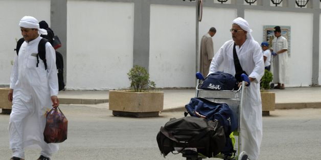 Algerian pilgrims arrive at Algiers airport on August 29, 2016, for their departure to the annual Hajj pilgrimage in the Islamic holy cities of Mecca and Medina in Saudi Arabia.The Hajj, the largest annual pilgrimage in the world, is the fifth pillar of Islam, a religious duty that must be carried out at least once in the lifetime of every able-bodied Muslim who can afford to do so. / AFP / RYAD KRAMDI        (Photo credit should read RYAD KRAMDI/AFP/Getty Images)