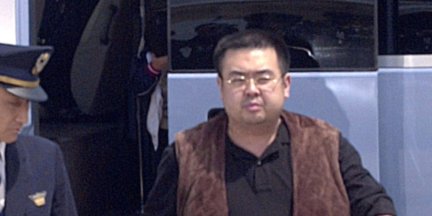A man (R) believed to be North Korean heir-apparent Kim Jong Nam, is escorted by police as he boards a plane upon his deportation from Japan at Tokyo's Narita international airport in Narita, Japan, in this photo taken by Kyodo May 4, 2001. Picture taken May 4, 2001. Mandatory credit Kyodo/via REUTERS ATTENTION EDITORS - THIS IMAGE WAS PROVIDED BY A THIRD PARTY. EDITORIAL USE ONLY. MANDATORY CREDIT. JAPAN OUT. NO COMMERCIAL OR EDITORIAL SALES IN JAPAN.