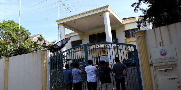 Members of the media are seen outside the North Korean embassy in Kuala Lumpur on February 18, 2017. North Korea's ambassador to Malaysia Kang Chol said Pyongyang would reject any results of a post-mortem examination carried out by Kuala Lumpur on the body of Kim Jong-Nam. / AFP / MANAN VATSYAYANA        (Photo credit should read MANAN VATSYAYANA/AFP/Getty Images)