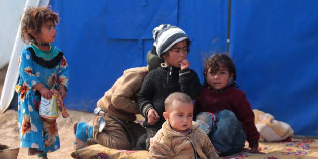 Displaced Iraqi children sit at the Al-Agha camp where Iraqi families from the nearby villages of Tal Afar, southwest of Mosul, are taking shelter as Iraqi forces continue their military operation to recapture Mosul from Islamic State (IS) jihadists on February 16, 2017.  / AFP / AHMAD AL-RUBAYE        (Photo credit should read AHMAD AL-RUBAYE/AFP/Getty Images)