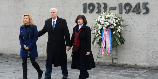 US Vice President Michael Richard Pence (C), his wife Karen Pence (R) and his daughter Charlotte Pence walk from the International Memorial of former Nazi concentration camp of Dachau after laying a wreath at the former Nazi concentration camp of Dachau, southwestern Germany, on February 19, 2017. / AFP / Thomas Kienzle        (Photo credit should read THOMAS KIENZLE/AFP/Getty Images)