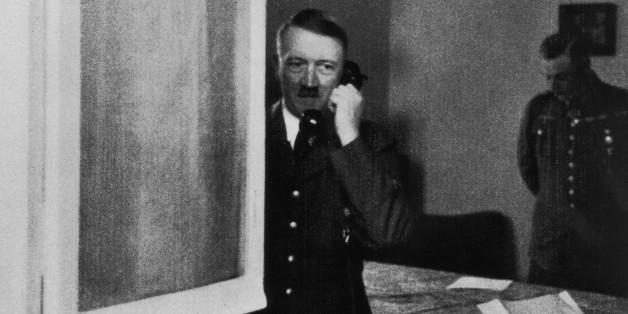 German Nazi leader Adolf Hitler (1889 - 1945) takes a phone call at Wolfsschlucht I - his headquarters at Bruly-de-Pesche, Belgium, May-June 1940. (Photo by Hulton Archive/Getty Images)