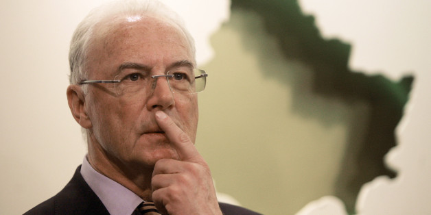 German football legend Franz Beckenbauer listens to questions during a news conference in Kosovo's capital Pristina March 4, 2011. REUTERS/Hazir Reka (KOSOVO - Tags: POLITICS SPORT SOCCER)