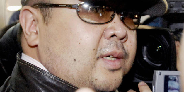 Beijing, CHINA: A man believed to be North Korean leader Kim Jong-Il's eldest son, Kim Jong-Nam, is surrounded by journalists upon his arrival at Beijing's capital airport, 11 February 2007. Wearing a cap, sunglasses and jeans, the man who Japanese television crew described as Kim Jong-Nam arrived at Beijing's airport from Macau in the afternoon, as six-nation talks on ending North Korea's nuclear weapons programme were underway in the Chinese capital.  Kim Jong-Nam, 35, was recently reported to have been living the high life in Macau, a southern China casino haven, for most of the past three years.  JAPAN OUT     AFP PHOTO / JAPAN POOL via JIJI PRESS (Photo credit should read AFP/AFP/Getty Images)