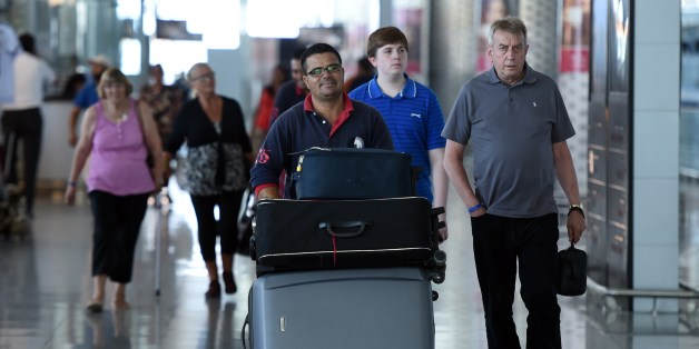 Tourists arrive at the Enfidha International airport on July 10, 2015. Denmark followed Britain's example in urging its nationals to cut short their holidays in Tunisia after London warned the country was still unsafe after last month's beach massacre. AFP PHOTO / FETHI BELAID        (Photo credit should read FETHI BELAID/AFP/Getty Images)