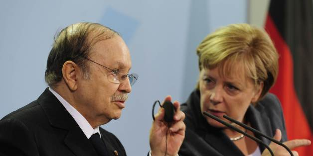 German Chancellor Angela Merkel (R) and Algerian President Abdelaziz Bouteflika address a press conference at the chancellery in Berlin December 8, 2010.      AFP PHOTO / JOHN MACDOUGALL (Photo credit should read JOHN MACDOUGALL/AFP/Getty Images)