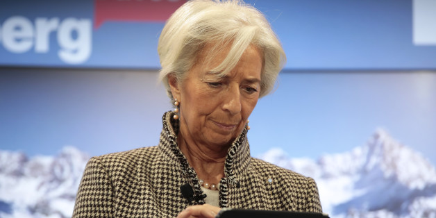 Christine Lagarde, managing director of the International Monetary Fund (IMF), uses a tablet device ahead of a panel session at the World Economic Forum (WEF) in Davos, Switzerland, on Wednesday, Jan. 18, 2017. World leaders, influential executives, bankers and policy makers attend the 47th annual meeting of the World Economic Forum in Davos from Jan. 17 - 20. Photographer: Jason Alden/Bloomberg via Getty Images