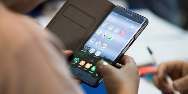 A woman checks her Samsung Electronics Co. Galaxy Note 7 smartphone at a Samsung kiosk providing rental phones for users of the Note 7 at Incheon International Airport in Incheon, South Korea, on Tuesday, Oct. 25, 2016. In what may be the first Note 7 related class-action lawsuit filed in South Korea, 527 smartphone buyers are demanding Samsung Electronics Co. pay each plaintiff about 500,000 won (about $440) for time and effort lost when the phones were first recalled and then scrapped amid rep
