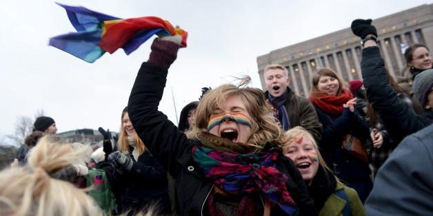 Supporters of the same-sex marriage celebrate outside the Finnish Parliament in Helsinki, Finland on November 28, 2014 after the Finnish parliament approved a bill allowing homosexual marriage. AFP PHOTO /Lehtikuva/ MIKKO STIG*** FINLAND OUT ***        (Photo credit should read MIKKO STIG/AFP/Getty Images)
