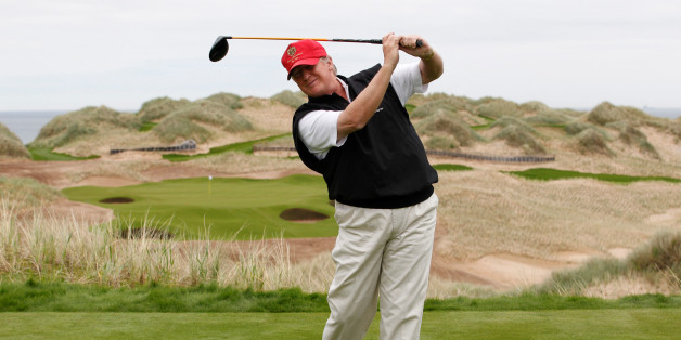U.S. property magnate Donald Trump practices his swing at the 13th tee of his new Trump International Golf Links course on the Menie Estate near Aberdeen, Scotland, Britain June 20, 2011. To match Special Report USA-ELECTION/TRUMP-GOLF  REUTERS/David Moir/File Photo