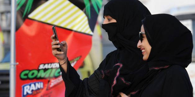A Saudi woman films using her mobile during the first ever Comic-Con event in the coastal City of Jeddah, on February 16, 2017. The first edition of the US-based pop culture Comic-Con is being held in Saudi Arabia featuring a mix of robots, gaming and Saudi television and film industry luminaries. / AFP / FAYEZ NURELDINE        (Photo credit should read FAYEZ NURELDINE/AFP/Getty Images)
