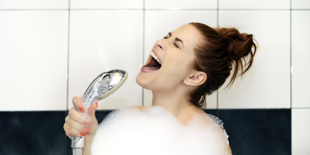 woman singing at shower hard.