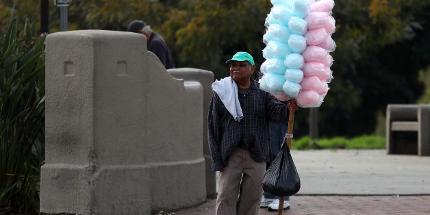 LOS ANGELES, CA - FEBRUARY 16:  A street vendor carries cotton candy on February 16, 2017 in Los Angeles, California. The Los Angeles City Council unanimously voted Wednesday to decriminalize street vending in an effort to reduce chances of illegal immigrants being deported for criminal convictions.  (Photo by Justin Sullivan/Getty Images)