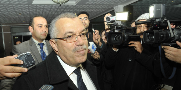 Tunisian justice minister and candidate for the post of prime minister, Noureddine Bhiri speaks to journalists as he arrives for a meeting at Ennahda ruling party's headquarters on February 21, 2013 in Tunis. Tunisia was scrambling to find a replacement prime minister and pull itself out of a major political crisis two days after Hamadi Jebali quit after failing to form a cabinet of technocrats. AFP PHOTO / FETHI BELAID        (Photo credit should read FETHI BELAID/AFP/Getty Images)