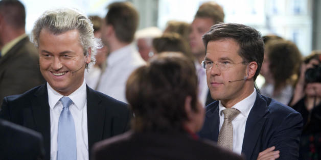 Dutch extreme-right MP Geert Wilders (L)' Party for Freedom Right-wing party is flanked by VVD leader (People's Party for Freedom and Democracy) Mark Rutte (R) ahead of a televised debate about the European Parliament elections in the Netherlands on June 04 2009 in The Hague, Netherlands. First results show that Wilders's party is taking 15.3 percent of the ballot and four seats in its first-ever campaign. the anti-Islamisation standard-bearer's PVV party was second only to Prime Minister Jan Peter Balkenende's Christian Democrats (CDA), which dropped nearly five percent to 19.6 percent and lost two of its seven European parliament seats.  AFP     PHOTO  ANP ROBIN UTRECHT   **NETHERLANDS OUT  BELGIUM OUT** (Photo credit should read ROBIN UTRECHT/AFP/Getty Images)