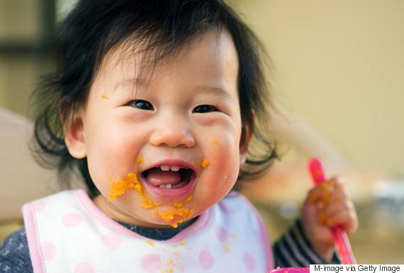 eating mess baby girl
