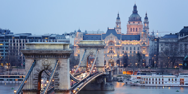 a view of the Chain Bridge in budapest early in the evening