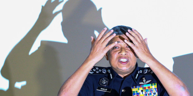 Malaysia's Royal Police Chief Khalid Abu Bakar demonstrates to the media during a news conference regarding the apparent assassination of Kim Jong Nam, the half-brother of the North Korean leader, at the Malaysian police headquarters in Kuala Lumpur, Malaysia, February 22, 2017. REUTERS/Athit Perawongmetha