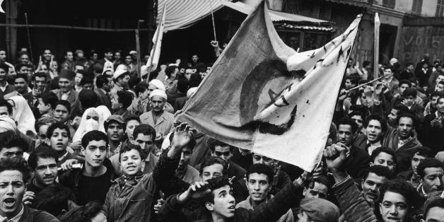 ALGERIA - CIRCA 1961:  The Algerian War In Algiers, Algeria In 1961 - Algerian demonstrations followed one another beginning in the fall-100 died and over 12,000 were arrested.  (Photo by Dominique BERRETTY/Gamma-Rapho via Getty Images)