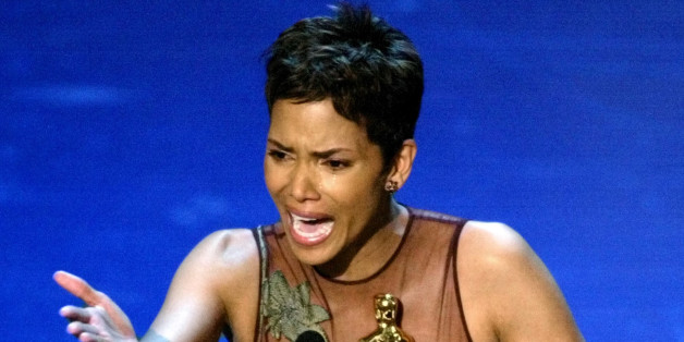 """Actress Halle Berry reacts to winning the Oscar for Best Actress during the 74th annual Academy Awards in Hollywood March 24, 2002. Berry won the Academt Award for her role in the film """"Monster's Ball"""". REUTERS/Gary Hershorn PICTURE EMBARGOED FROM REDISTRIBUTION FOR ONLINE/INTERNET USE UNTIL CONCLUSION OF ACADEMY AWARDS TELECAST  JM"""