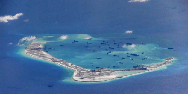 FILE PHOTO: Chinese dredging vessels are purportedly seen in the waters around Mischief Reef in the disputed Spratly Islands in the South China Sea in this still image from video taken by a P-8A Poseidon surveillance aircraft provided by the United States Navy May 21, 2015.  U.S. Navy/Handout via Reuters/File Photo   ATTENTION EDITORS - THIS IMAGE WAS PROVIDED BY A THIRD PARTY. EDITORIAL USE ONLY. THIS PICTURE WAS PROCESSED BY REUTERS TO ENHANCE QUALITY. AN UNPROCESSED VERSION IS AVAILABLE IN OU