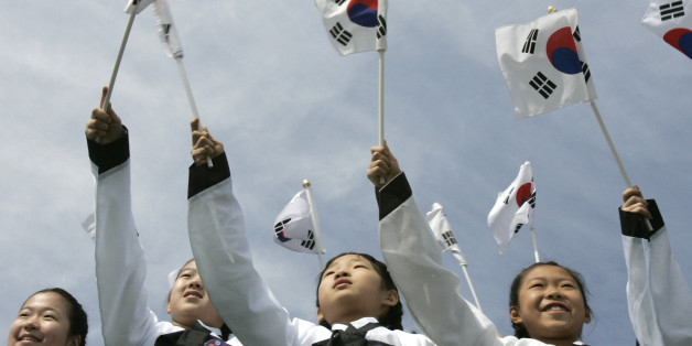 Girls wave national flags during the 90th anniversary of the Independence Movement at Independence Hall in Cheonan, about 92 km (57 miles) south of Seoul, March 1, 2009. Performers also re-enacted the March 1 Independence Movement against Japanese colonial rule in 1919 during which some 7,509 Koreans were killed, 15,961 were injured and 46,948 were arrested and put in prison by the Japanese army, which had forcibly occupied the Korean peninsula in 1910-1945, according to the South Korean governm