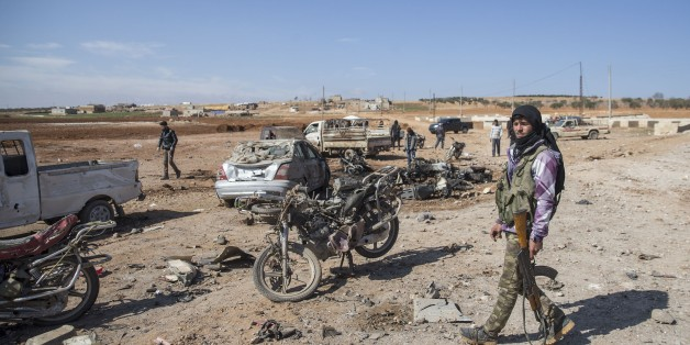 ALEPPO, SYRIA - FEBRUARY 24:  Site of the bomb attack by the Daesh terrorist group killing at least 35 people in northern Syria's strategic Al-Bab area on February 24, 2017. Daesh detonated a bomb-laden vehicle at a Free Syrian Army (FSA) position in Susyan village, according to local sources. Initial reports indicated at least 35 people died, with civilians and FSA members among the fatalities, the sources added. (Photo by Emin Sansar/Anadolu Agency/Getty Images)