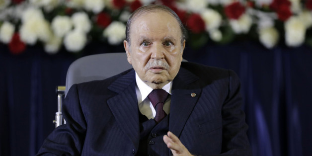 President Abdelaziz Bouteflika gestures during a swearing-in ceremony in Algiers April 28, 2014. Bouteflika was sworn in for a fourth term on Monday after easily winning an election opponents dismissed as fraudulent to re-appoint the ailing independence veteran after 15 years in power.  REUTERS/Louafi Larbi (ALGERIA - Tags: POLITICS ELECTIONS)