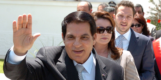 Tunisian President Zine El Abidine Ben Ali (front) waves to wellwishers after voting for the municipal elections next to his wife Leila (C) and his son-in-law the Tunisian businessman Sakhr Materi (R) on May 9, 2010 in Tunis. Polls opened in Tunisia on May 9, 2010, for municipal elections in which the ruling party of long-time President Zine El Abidine Ben Ali is widely tipped to come out victorious. AFP PHOTO/ FETHI BELAID (Photo credit should read FETHI BELAID/AFP/Getty Images)