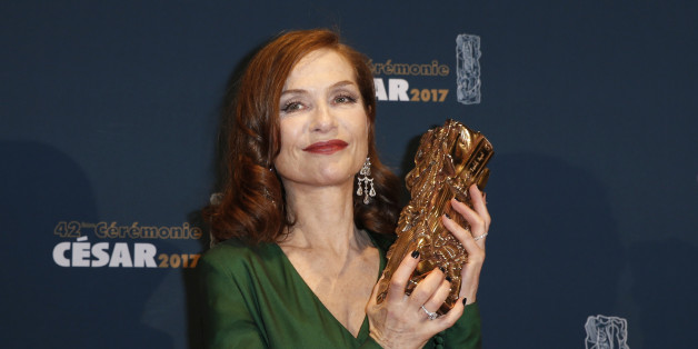 "Actress Isabelle Huppert holds her trophy during a photocall after receiving the Best Actress Award for her role in the film ""Elle"" at the 42nd Cesar Awards ceremony in Paris, France, February 24, 2017.          REUTERS/Gonzalo Fuentes"