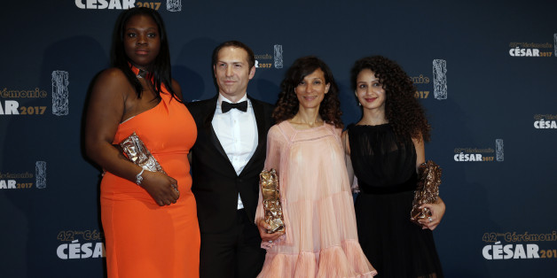 "Director Houda Benyamina poses during a photocall with producer Marc-Benoit Creancier, actress Deborah, Best Supporting Actress Award, and actress Oulaya Amamra, Best Female Newcomer Award, for the film ""Divines"" at the 42nd Cesar Awards ceremony in Paris, France, February 24, 2017.      REUTERS/Gonzalo Fuentes"