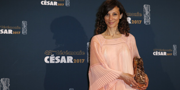 "Director Houda Benyamina poses with her trophy during a photocall after receiving the Best First Film Award for her film ""Divines"" at the 42nd Cesar Awards ceremony in Paris, France, February 24, 2017.     REUTERS/Gonzalo Fuentes"