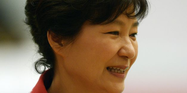 South Korean President Park Geun-Hye attends the ASEAN Plus Three Summit at the Myanmar International Convention Center in Myanmar's capital Naypyidaw on November 13, 2014.  The Association of Southeast Asian Nations (ASEAN) and East Asia summits, held in the purpose-built capital of Naypyidaw this week, are the culmination of a year of diplomatic limelight for Myanmar after long decades shunted to the sidelines under its former military rulers. AFP PHOTO / Christophe ARCHAMBAULT        (Photo c