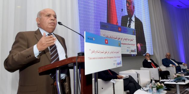 Tunisian Minister of Public Service and Governance, Abid Briki (L), speaks during the opening of the National Conference to Combat Corruption, on December 8, 2016, in Tunis. / AFP / FETHI BELAID        (Photo credit should read FETHI BELAID/AFP/Getty Images)