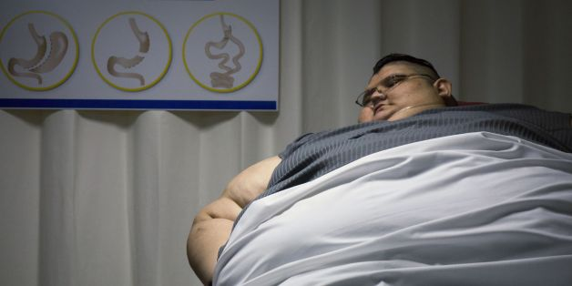 Mexican 32-year-old Juan Pedro Franco, who weighs almost 500 kilograms (1100 pounds) answers questions during a press conference at the hospital in Guadalajara, Mexico on December 21, 2016.  Franco, who suffers from extreme obesity and has remained six years confined to bed, unable to walk, is being assessed by doctors and will begin a special diet and exercise routine with the aim to lose 59 kilograms before undergoing a by-pass biliopancreatic diversion in two times in June 2017. / AFP / Héctor Guerrero        (Photo credit should read HECTOR GUERRERO/AFP/Getty Images)