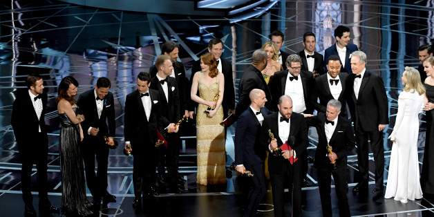 HOLLYWOOD, CA - FEBRUARY 26:  Prior to learning of a presentation error, 'La La Land' producers Jordan Horowitz (speaking at microphone), Fred Berger and Marc Platt accept the Best Picture award for 'La La Land' (later awarded to actual Best Picture winner 'Moonlight') onstage during the 89th Annual Academy Awards at Hollywood & Highland Center on February 26, 2017 in Hollywood, California.  (Photo by Kevin Winter/Getty Images)