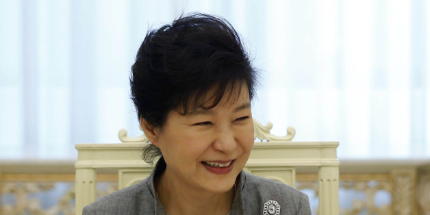 "South Korean President Park Geun-hye smiles as she listen to a reporter's question during an interview with Reuters at the Presidential Blue House in Seoul September 16, 2014. Park, thwarted so far in ambitious plans to begin the process of reunifying the Korean peninsula, said the door is open for talks with the North during the upcoming U.N. General Assembly. However, Park said in the interview that Pyongyang must show sincerity in seeking a constructive dialog and ""walk the talk"" in taking up South Korea's offers for engagement aimed at ending a deadlock after a decade of warming ties. Picture taken on September 16. To match Exclusive SOUTHKOREA-PRESIDENT/INTERVIEW REUTERS/Kim Hong-Ji (SOUTH KOREA - Tags: POLITICS)"